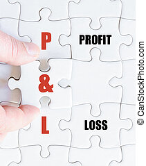 Last puzzle piece with Business Acronym P and L - Hand of a...