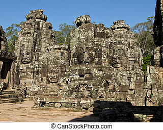 group of faces - The picture of antient temple of cambodia