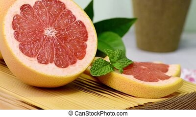 Ripe grapefruit close-up on wooden table background