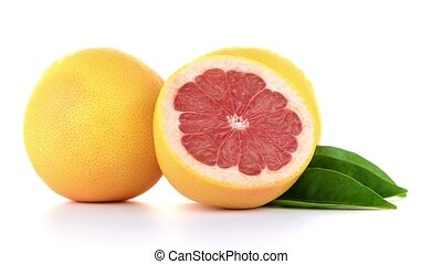 Ripe cut red grapefruit isolated on white background