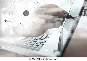 business man hand working on laptop computer on wooden desk...