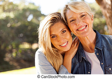 middle aged blond mother and adult daughter