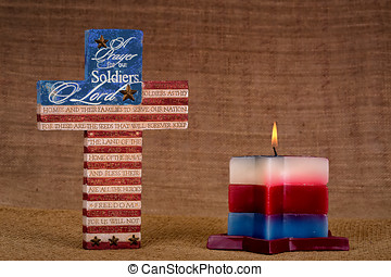 Cross with prayer for soldiers and candle on canvas