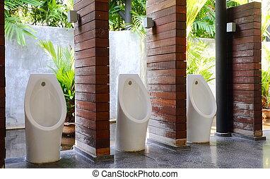 White porcelain urinals in men public toilets