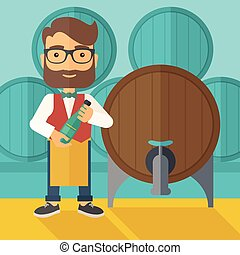 Wine maker inspecting wine from barrel. - A wine maker...