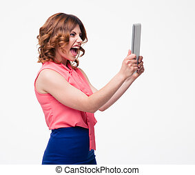 Angry woman shouting on tablet computer isolated on a white...