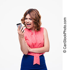 Angry woman using smartphone isolated on a white background