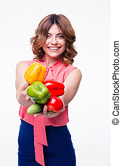 Happy pretty woman holding vegetables isolated on a white...