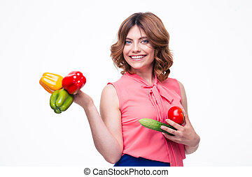Smiling attractive woman holding vegetables isolated on a...