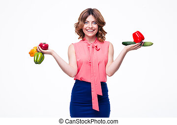 Happy beautiful woman holding vegetables isolated on a white...