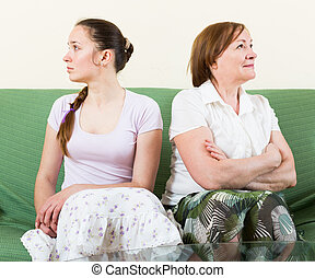 mother and daughter after quarrel - Mature mother and...