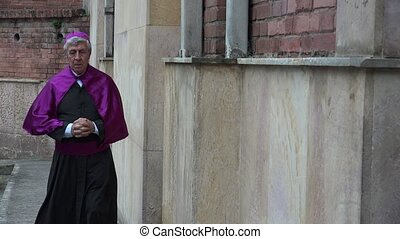 Priest Walking at Church