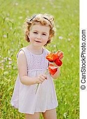 girl in field - cute little girl standing near in field with...