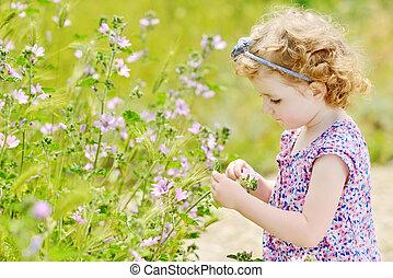 toddler girl in field - pretty toddler girl in spring near...
