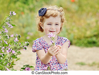 cute girl with flower - cute and fashion toddler girl in...