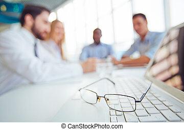Eyeglasses on keypad - Eyeglasses on laptop keypad with...