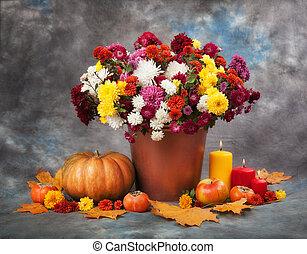 Autumn Still Life Flowers, candles and pumpkin