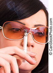 Health issues concept - Young girl smoking cigarette