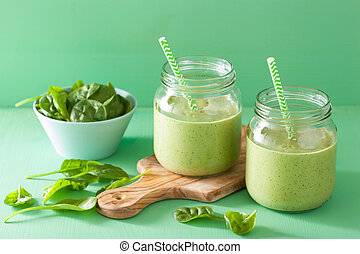 healthy green smoothie with spinach mango banana in glass...