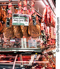 BARCELONA, SPAIN - MAY 12, 2015: Meat shop with Iberian Ham...