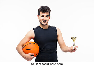 Basketball player holding winners cup