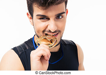Sports man biting medal isolated on a white background....