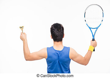 Man holding tennis racket and cup