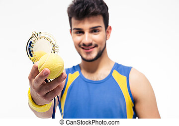 Happy sports man holding medal and tennis ball