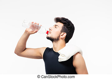 Sports man drinking water with bottle isolated on a white...