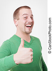 young man giving thumbs up - young man with big toothy smile...