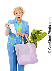 Shockingly High Food Prices - Senior woman shocked by the...