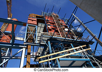 cranes and beams on construction of industrial factory