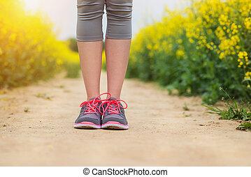 Young woman running - Beautiful woman running outside in...