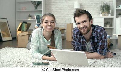 Online Shopping - Pan shot of a living room with a couple...