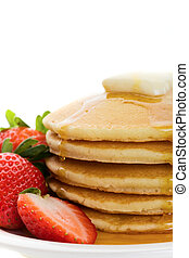 golden pancakes - Fluffy golden pancakes with strawberries...