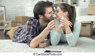 Living Together - Close up of man giving his girlfriend the...