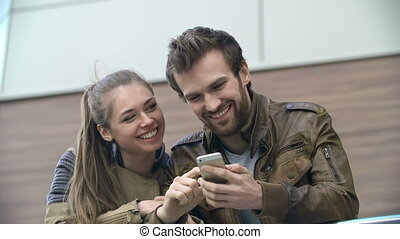 Wireless Internet - Close up of young couple looking at...