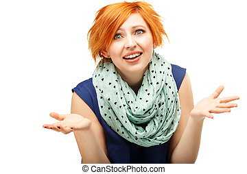 Close-up portrait of a funny red-haired girl emotionally gesticulating and waving his hands