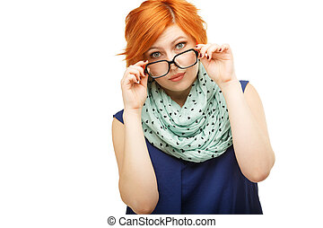 Portrait of surprised red-haired young woman holding glasses...