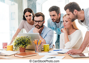 Successful business team at work. Group of confident...