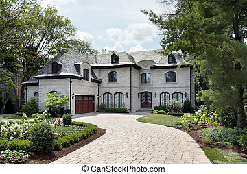 Luxury home with circular driveway - Front view of luxury...
