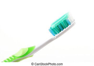 teeth brush - white and green teeth brush over white...