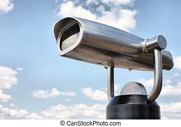 viewing binoculars - steel binoculars over blue sky and...