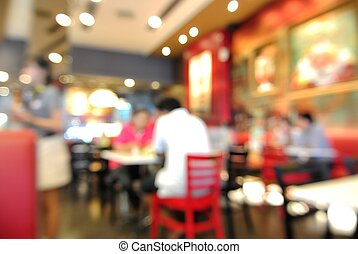 Blur or Defocus Background of People eating in Restaurant or...