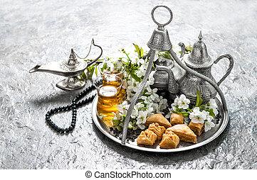 Islamic holidays food with decoration. Ramadan kareem. Eid...