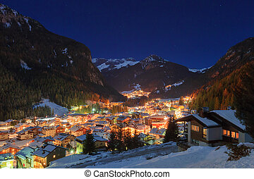 Winter landscape of village in the mountains - Night in Alps...