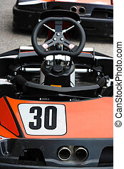 Number thirty - Backside of a racing go kart with focus on...