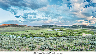 dusk over North Platte River in Colorado North park above...