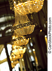 Chandeliers - Luxurious classic glass chandeliers inside a...