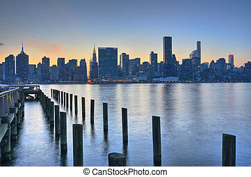 New York City Skyline Sunset - United nations building on...